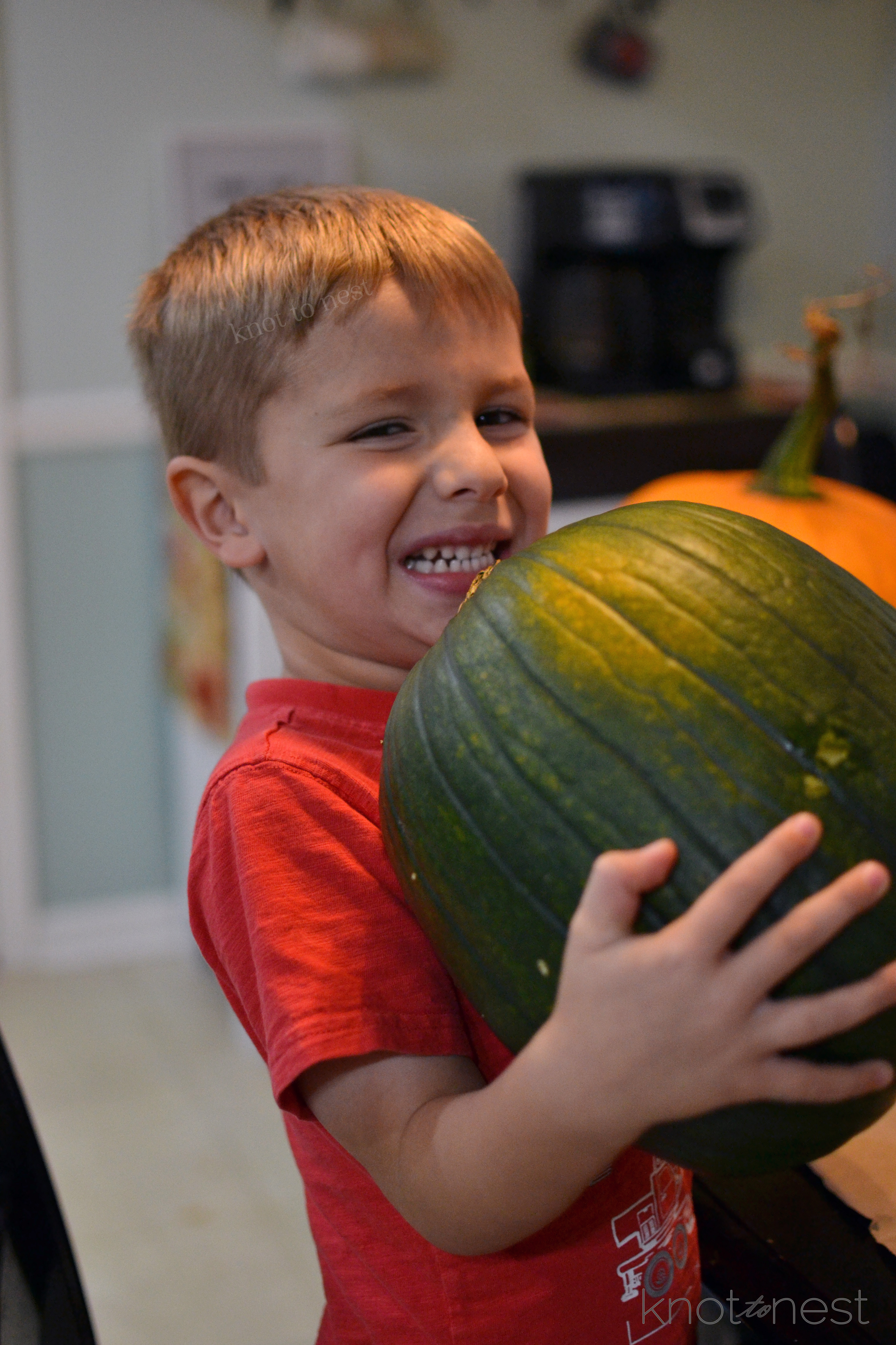 carving a green pumpking