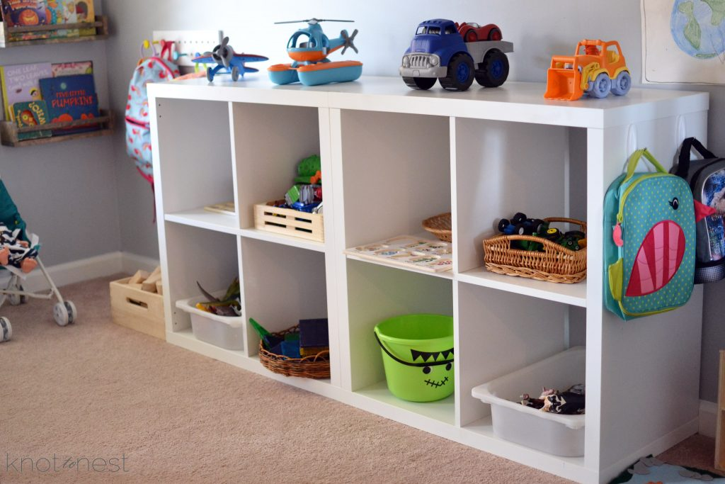 shelf of toys in playroom
