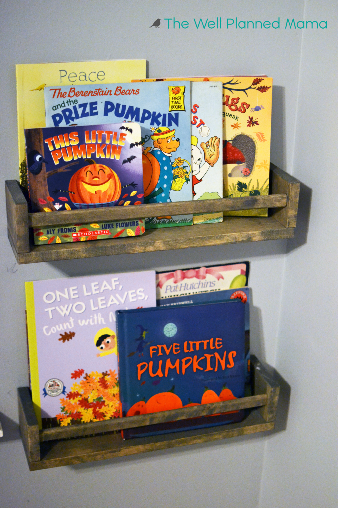 Wall mounted book shelves for children with Halloween themed books