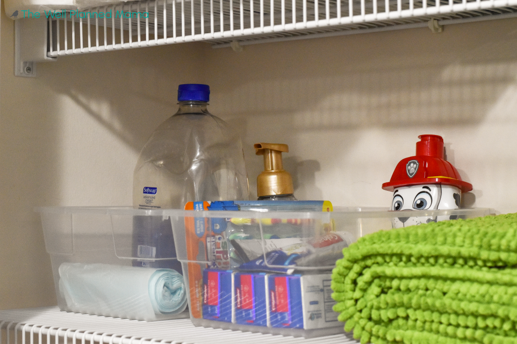 Clear containers used to help with linen closet storage