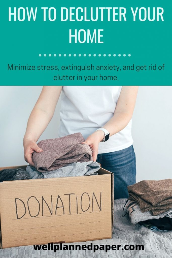 donation box filling with clothes from a declutter