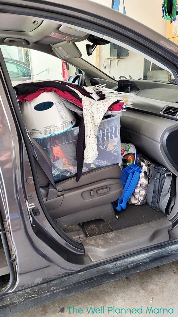 A van packed full for a children's consignment sale.